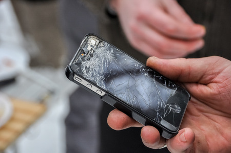 portable failure: phone with a broken screen in a hand Stock Photo