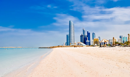 sea scene: sunny beach and cityscape in Abu Dhabi, UAE Stock Photo