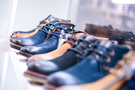 men's shoes on the shelves in the store