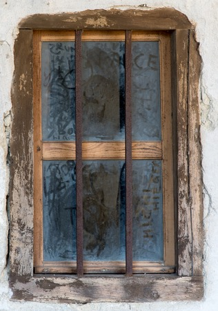 metal bars: an old window with the metal bars