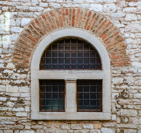metal bars: old window with metal bars in a brick wall