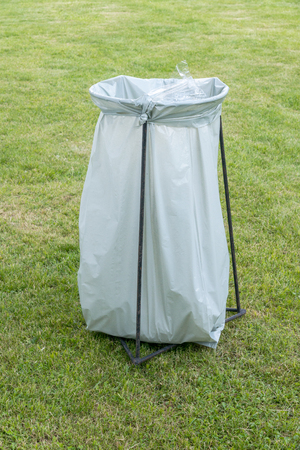 disposed: the trashcan - a plastic garbage bag on an iron frame Stock Photo