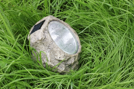 photocell: garden lamp with photocell in the wet grass