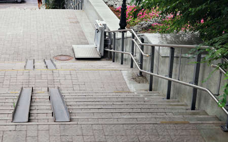 Electric lift designed for wheelchair to overcome the height of city street stairs