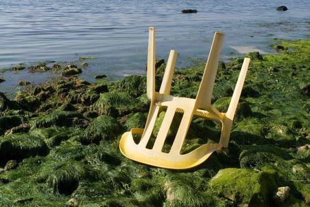 broken chair: Broken chair at the beach Stock Photo