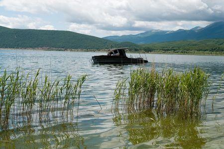 Abandoned boat at Great Prespa lake photo