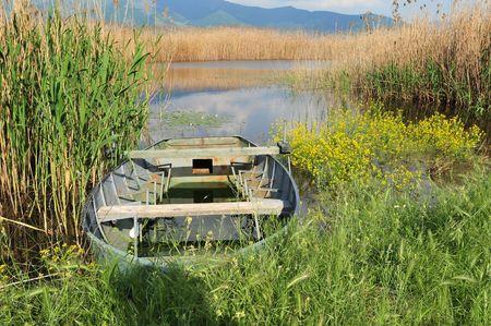 Fishing boat at Minor Prespa lake, Greece photo