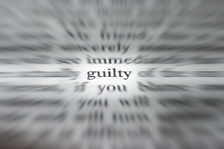 guilty: Macro photograph of the word guilty - concept