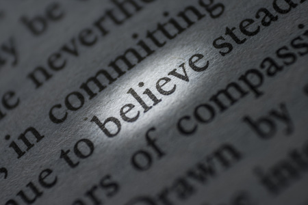 macro photograph of the word believe - concept