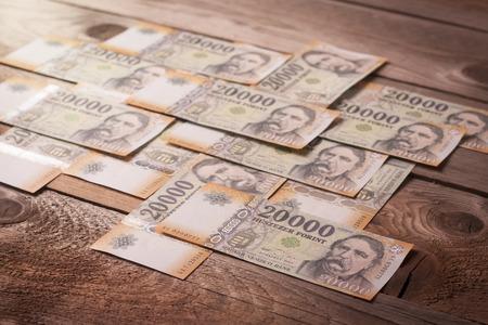 Money on a wooden table - Time is money concept Reklamní fotografie