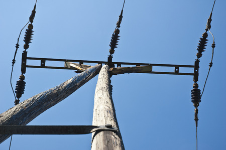 electrochemical: old wooden electricity pole with blue sky as a close-up