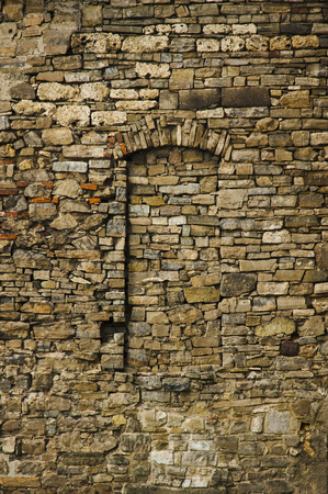 Walled up window on medieval castle