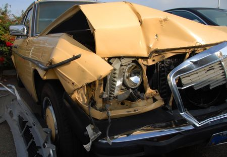 A yellow car after an accident