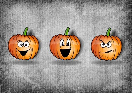 zucche halloween: tre zucche di Halloween sulla texture grigia