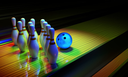 rainbow scene: Glossy bowling ball and skittles on the alley. Dark scene with rainbow shining colors. Stock Photo