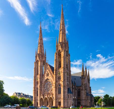 sacral: Church (Eglise) St. Paul in Strasbourg. Alsace region in France. Big sacral building under the blue sky.