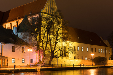 budweis: Night architecture in the city. Old church on the bank of river. Czech Budweis.