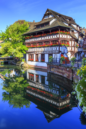 le: STRASBOURG, FRANCE, AUGUST 06 2016. View of embankment of the Ill river in Petite France district with Maison des Tanneurs (tanners house), Strasbourg, France