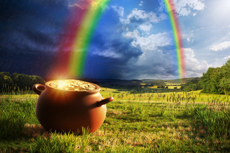 Pot full of gold at the end of the rainbow. Stock Photo