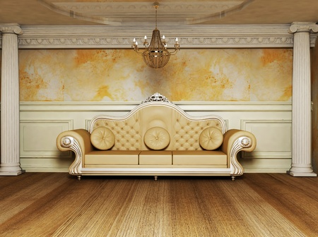 this is an antique interior with a beautiful sofa and the columns Stock Photo