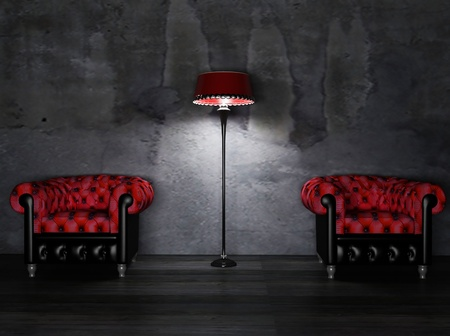 red chair: there are two red and black armchairs and a lamp on the dirty background