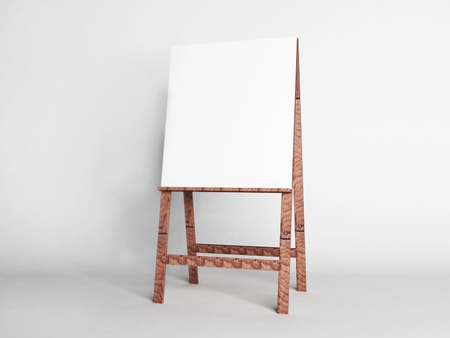 beautiful wooden easel on a white background photo