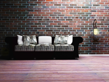 this is a black and white sofa with the  pillows and a lamp on the wall photo