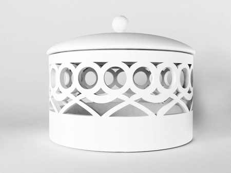 beautiful ceramic white casket on the white background photo
