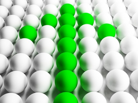 leadership abstract: the green arrow which makes the way through the balls Stock Photo