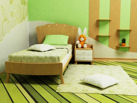 A nice green room for children with a sofa, shelves and a table photo