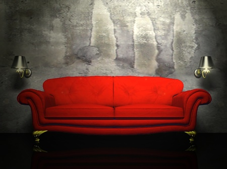 there is a red sofa and the two sconces on the dirty background photo