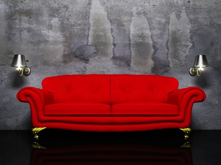 red sofa: there is a red sofa and the two sconces on the dirty background
