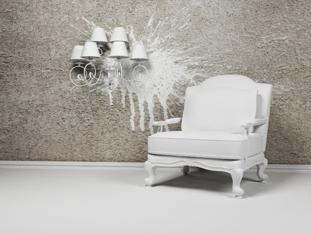 White armchair and a chandelier on the interesting creative background