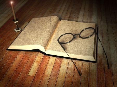studing: book, glasses and a candle on the table Stock Photo