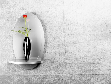 mirror on the gray wall and a vase with a rose photo
