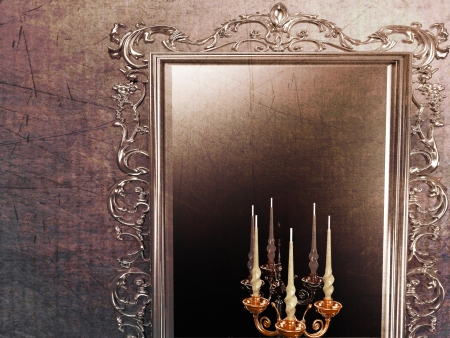 custom cabinet: a large antique mirror and candle holder Stock Photo