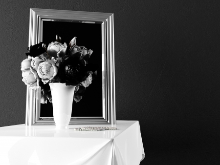 beautiful vase with the flowers near the mirror  photo