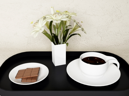 a chocolate, the flowers and coffee on a tray photo