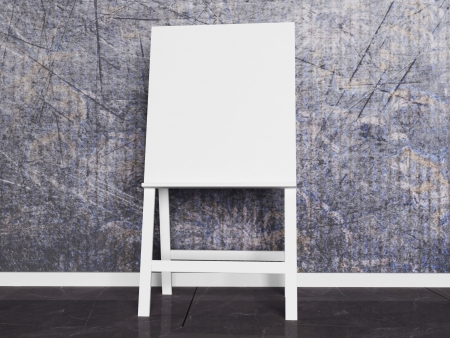 white wooden easel on a gray background Stock Photo - 14679236