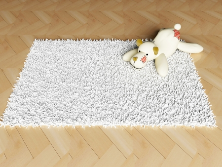 funy: soft fluffy toy on the carpet Stock Photo