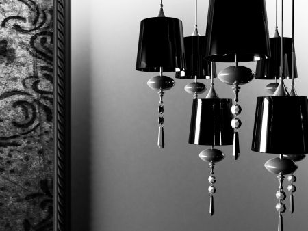 black vintage chandelier on gray background photo