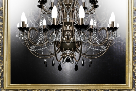 beautiful antique chandelier on grunge background photo