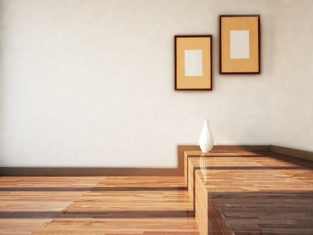 two pictures on the wall and a vase on the floor