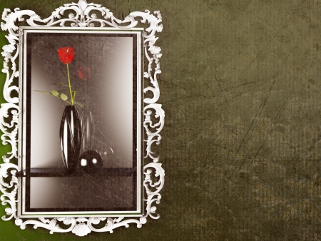 a red rose in the dark vase near the mirror photo