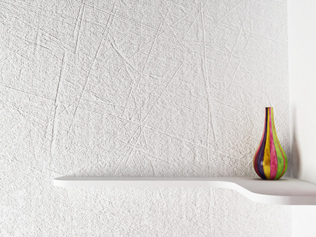 vase plaster: colored vase on the shelf Stock Photo