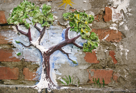 wood carvings: decorative tree on the brick wall