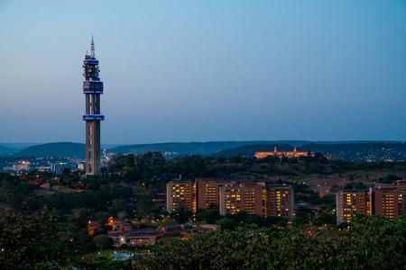 gauteng: Pretoria, South Africa - October 18, 2015: Telkom tower in Pretoria from Fort Klapperkop, with the Union buildings in the background