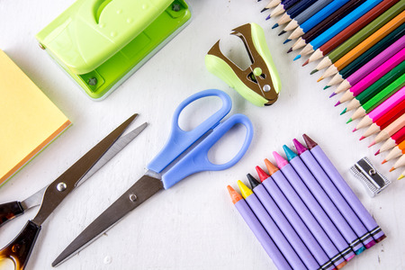 color pencils: Stationery: Pens, scissors, color pencils on old white table top
