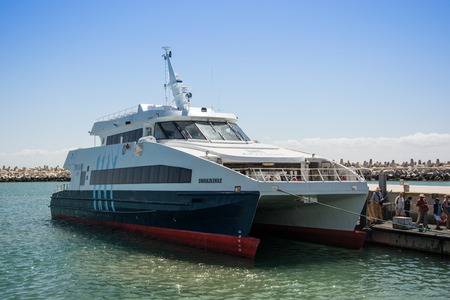 robben island: Cape Town, South Africa - March 03, 2017: Visitors to Robben Island arrive by Catamaran from the V&A Waterfront, Cape Town