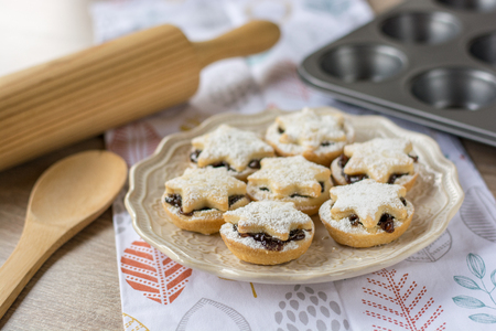 Christmas fruit mince pies on a plate Stock Photo